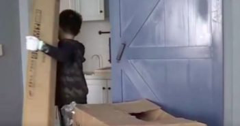 young boy moving cardboard in china