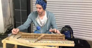 man making musical instrument out of chopsticks