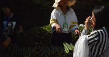 woman selling cucumbers at tourist spot in china