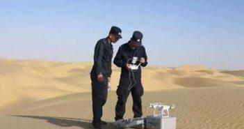 police preparing drone in desert in xinjiang