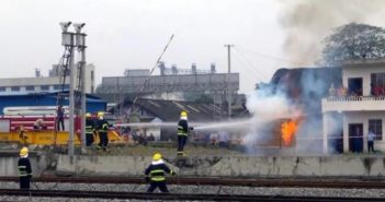 firefighters fighting fire next to railway in china