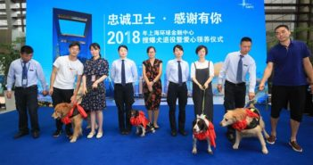 people and dogs on stage at shanghai financial center