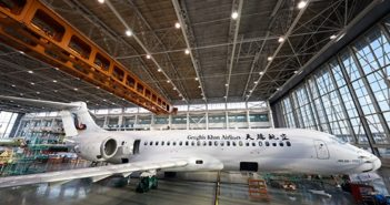 side view of genghis khan airlines plane in hanger
