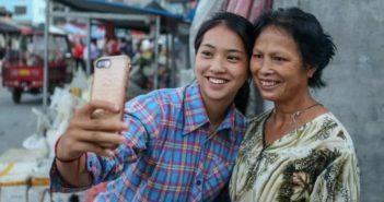girl taking selfie with mother in guizhou village