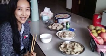 woman eating dumplings in china