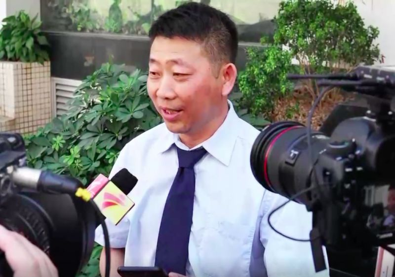 man giving interview in china