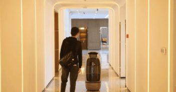 robot leading customer at ai management hotel in hangzhou