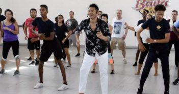 chinese instructor teaching salsa class