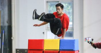 man practicing parkour in china