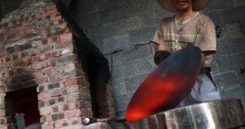man making a wok in china