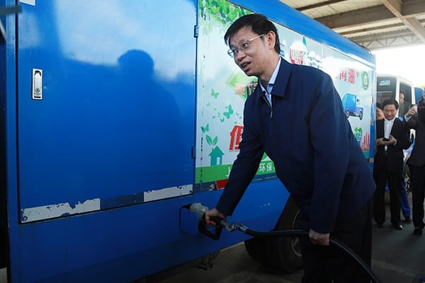 driver topping up tank in china