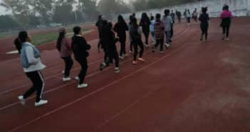 students running on track at university in china