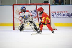 Youngsters play ice hockey in Beijing