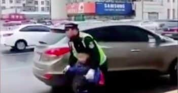 police officer with student on busy road in china
