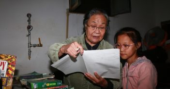 old lady helping young girl study in china