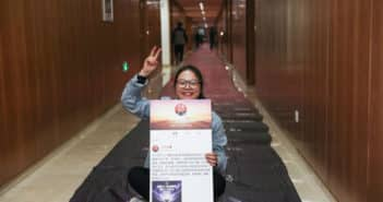 woman with singles' day prize certificate