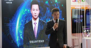 news anchor standing in front of ai anchor based on him in china