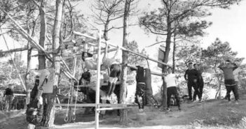 black and white photo of people working out at bamboo gym in ningbo