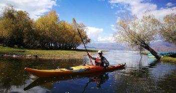 kayaker in kayak on river