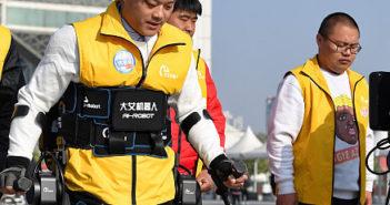 man walking aided by robotic exoskeleton