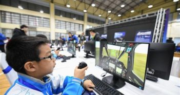 child on flight simulator at competition in china