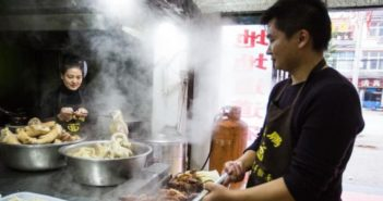 husband at wife in restaurant kitchen in china
