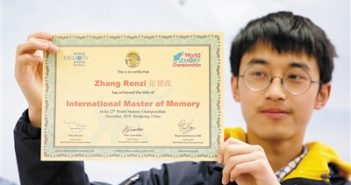 boy holding master of memory certificate