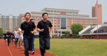 students running on athletics track at chinese university
