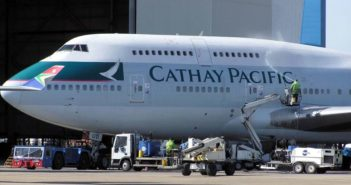 side view of front part of cathay pacific plane being washed