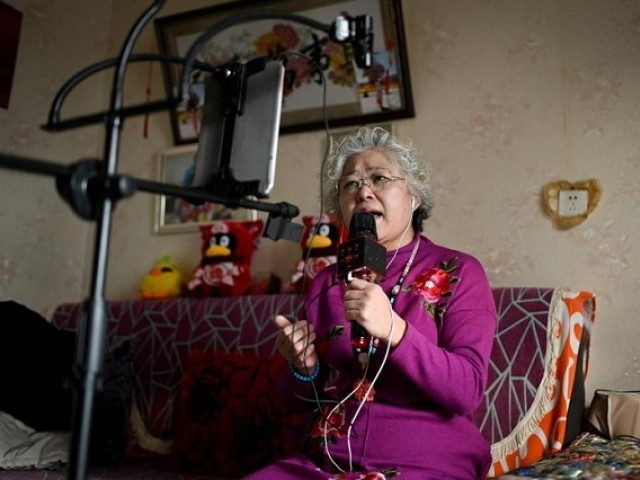 elderly woman doing live stream from home in china