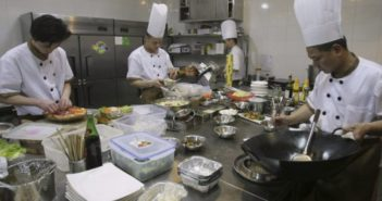 chefs at work in kitchen in china