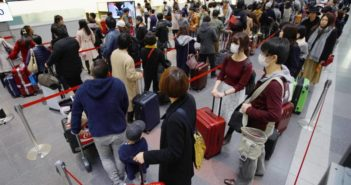 passengers in queue at airport in japan