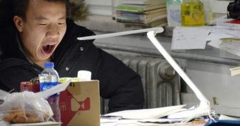 student yawning while studying