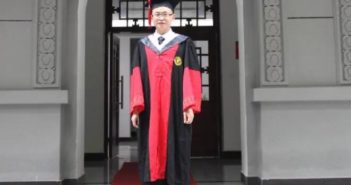 graduate posing for a photo in china