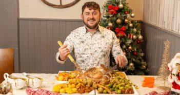 man with huge christmas dinner