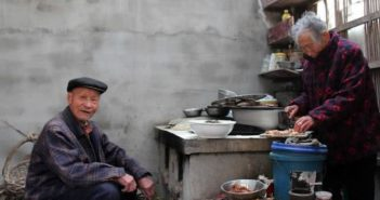 elderly mother and son at home preparing food in china