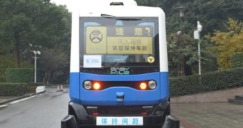 front view of 5g self-driving bus on road in chongqing