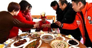 family celebrating old lady's birthday in china
