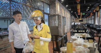 take out courier collecting food at restaurant in china