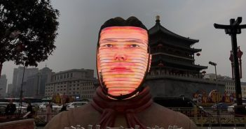 photo of face displayed on giant replica terracotta warrior