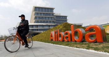 man on bike outside alibaba building
