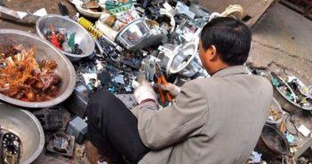 man sorting rubbish in china