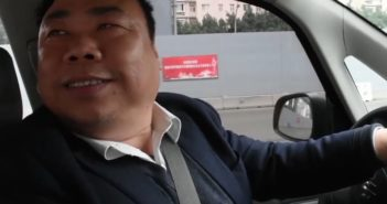 taxi driver in chongqing looking over his shoulder