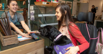 dog paying at shop with contactless card