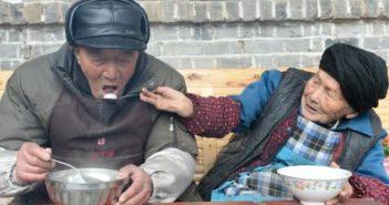 wife feeding husband