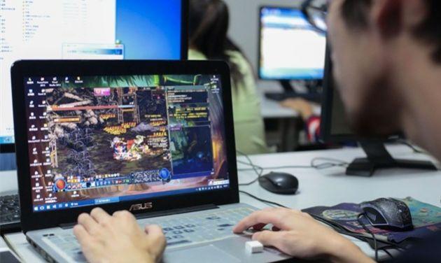 man playing computer game