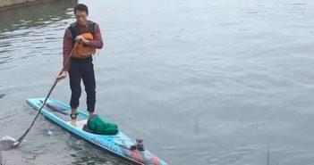 man on paddle board on yangtze river in chongqing