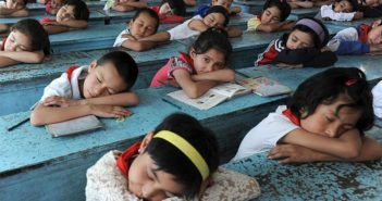 children taking a nap at school in china