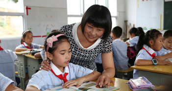 teacher in classroom with children in china