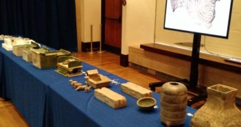 chinese cultural relics displayed on a table